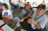 NWA Democrat-Gazette/DAVID GOTTSCHALK Army veteran Richard Howard (right) visits Thursday, July 4, 2019, with Mark Weathers, retired navy, during the annual 4th of July Cookout at the Arkansas State Veterans Home in Fayetteville. The cookout featured live music, carnival games and food for guests, family members, employees and the residents.