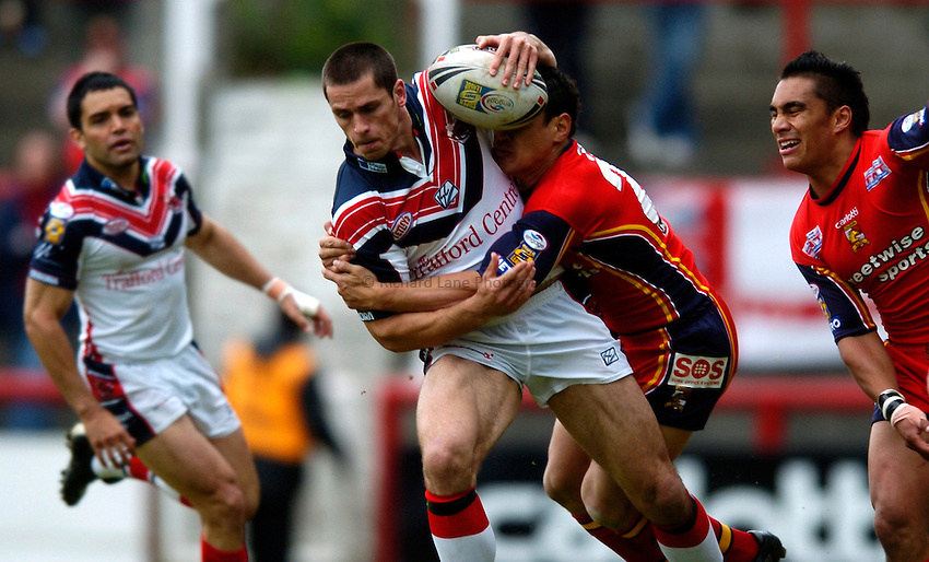 Photo. Richard Lane..London Broncos v Salford City Reds. Engage Super League. 22/05/2005..Nathan McAvoy is tackled.