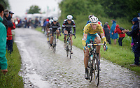 Vincenzo Nibali (ITA/Astana) surprises everybody with his skills and power on the cobbles<br /> <br /> 2014 Tour de France<br /> stage 5: Ypres/Ieper (BEL) - Arenberg Porte du Hainaut (155km)