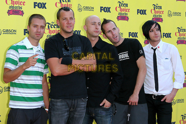 SIMPLE PLAN.2005 Teen Choice Awards - Arrivals- held at the Gibson Amphitheatre, Universal City, CA..August 14th, 2005.Photo credit: Jacqui Wong/AdMedia.half length stripes hand gesture arms crossed.www.capitalpictures.com.sales@capitalpictures.com.© Capital Pictures.