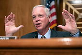 """United States Senator Ron Johnson, Chairman, US Senate Committee on Homeland Security & Governmental Affairs, makes an opening statement prior to hearing testimony on """"Examining CMS's Efforts to Fight Medicaid Fraud and Overpayments"""" on Capitol Hill in Washington, DC on Tuesday, August 21, 2018.<br /> Credit: Ron Sachs / CNP"""