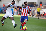 Atletico de Madrid´s Cristian Rodriguez (R) and Deportivo de la Coruña´s Diakhite during 2014-15 La Liga match between Atletico de Madrid and Deportivo de la Coruña at Vicente Calderon stadium in Madrid, Spain. November 30, 2014. (ALTERPHOTOS/Victor Blanco)