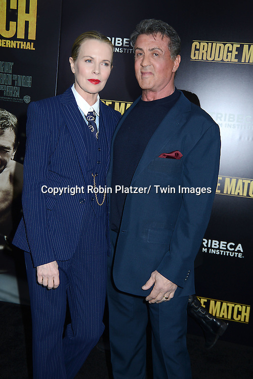 "Sylvester Stallone and Kim Basinger attend the World Premiere of ""Grudge Match"" at the Ziegfeld Theatre in New Yok City on December 16, 2013."