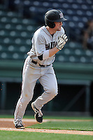 Left fielder Jack Colton (9) of the Harvard Crimson bats in a game against the Michigan State Spartans on Saturday, March 15, 2014, at Fluor Field at the West End in Greenville, South Carolina. Michigan State won, 4-0. (Tom Priddy/Four Seam Images)