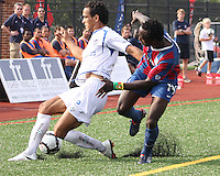 Mathew Mbuta #14 of Crystal Palace Baltimore loses the ball to Hicham Aaboubou #2 of the Montreal Impact during an NASL match at Paul Angelo Russo Stadium in Towson, Maryland on August 21 2010. Montreal won 5-0.