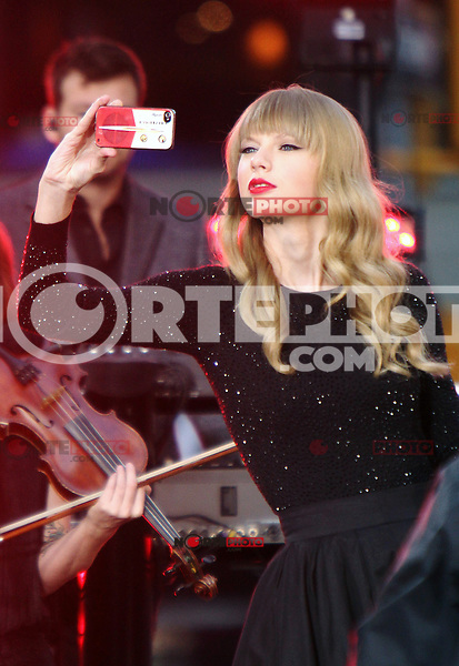 NEW YORK, NY - OCTOBER 23: Taylor Swift takes a photo of fans before her performance during the Good Morning America Concert Series in front of the Good Morning America Time Square studio in New York City. October 23, 2012. Credit: RW/MediaPunch Inc. /NortePhoto