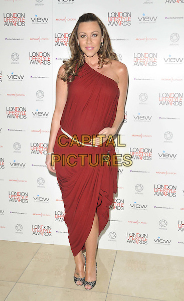 Michelle Heaton .The London Lifestyle Awards 2011, Park Plaza Riverbank hotel, Albert Embankment, London, England..October 6th, 2011.full length red one shoulder dress pregnant belt.CAP/CAN.©Can Nguyen/Capital Pictures.