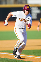 Kyle Geason #4 of the Minnesota Golden Gophers hustles down the third base line against the Towson Tigers at Gene Hooks Field on February 26, 2011 in Winston-Salem, North Carolina.  The Gophers defeated the Tigers 6-4.  Photo by Brian Westerholt / Sports On Film