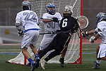 Nick Tuccillo (center) goalie for Holmdel High School can't get to the ball as Nick Fontana (center) from Southern Regional dives for the shot on goal as Holmdel takes on Southern Regional in a boys varsity lacrosse game held at Roggy Field at Holmdel High School in Holmdel on Thursday March 29, 2018.<br />  Mark R. Sullivan | For NJ Advance Media