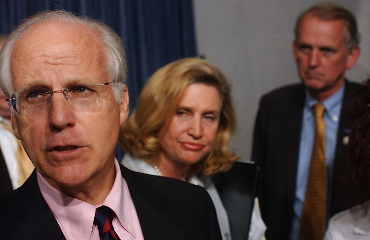 9/09/04.INTELLIGENCE OVERHAUL/SEPT. 11 LEGISLATION--Christopher Shays, R-Conn., and Carolyn B. Maloney, D-N.Y., talk to reporters after a news conference to introduce a bill similar to one (S 2774) introduced in the Senate by Lieberman and John McCain, R-Ariz., that closely tracks the commission's recommendations. House Majority Leader Tom DeLay, R-Texas,  said Wednesday the House would not take it up. Rob Simmons, R-Conn., is at right..CONGRESSIONAL QUARTERLY PHOTO BY SCOTT J. FERRELL