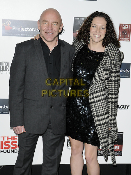 "DOMINIC LITTLEWOOD & GUEST .Attending the ""Malice In Wonderland"" UK Film Premiere, Prince Charles Cinema, Leicester Square, London, England, UK,.February 4th 2010..arrivals half length grey gray suit black shirt coat checked tartan plaid check sequined sequin dress paillettes .CAP/CAN.©Can Nguyen/Capital Pictures."