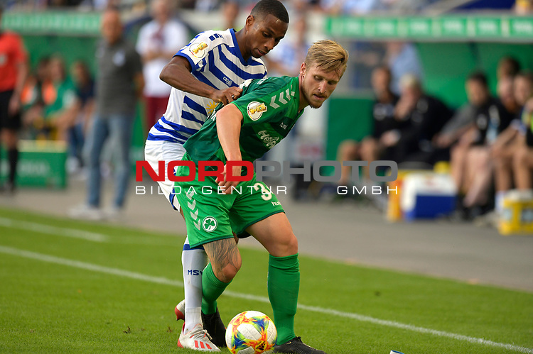 11.08.2019 , Schauinsland-Reisen Arena, Duisburg, DFB Pokal<br /> <br /> DFB REGULATIONS PROHIBIT ANY USE OF PHOTOGRAPHS AS IMAGE SEQUENCES AND/OR QUASI-VIDEO.<br /> <br /> im Bild / picture shows Leroy-Jacques Mickels ( MSV Duisburg #20 ) gegen Marvin Stefaniak ( Greuther Fuerth #34 ).<br /> <br /> Foto © nordphoto / Freund