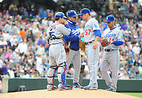 26 April 2009: Dodgers manager Joe Torre hands the game ball to pitcher Scott Elbert (57) while catcher Russell Martin and shortstop Juan Castro during a game between the Los Angeles Dodgers and the Colorado Rockies at Coors Field in Denver, Colorado. The Rockies defeated the Dodgers 10-4.  *****For Editorial Use Only*****