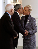 Washington, D.C. - March 5, 2008 -- United States President George W. Bush (C) kisses Cindy McCain on the cheek while welcoming her and Republican presidential nominee Sen. John McCain (R-AZ) (L) to the White House March 5, 2008 in Washington, DC. Bush will announce his endorsement of McCain for the GOP nomination in the Rose Garden after a private lunch. McCain reached the required 1,191 delegates necessary to clinch the nomination after Tuesday primaries in Ohio, Texas, Vermont and Rhode Island put him over the top.  .Credit: Chip Somodevilla - Pool via CNP