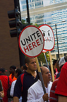 Images depicting an action taken by Hyatt hotel chain workers in Chicago against unfair treatment concerning wages and working conditions by the company. These pictures were taken outside the Hyatt Regency located at Michigan Avenue and Wacker Drive in downtown Chicago