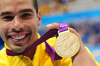 PICTURE BY ALEX BROADWAY /SWPIX.COM - 2012 London Paralympic Games - Day Nine - Swimming, Aquatic Centre, Olympic Park, London, England - 07/09/12 - Daniel Dias of Brazil poses with his Gold Medal after victory in the Men's 50m Butterfly S5 Final.
