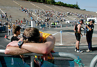 02 NOV 2003 - ATHENS, GREECE - A competitor recovers after finishing the 21st Athens Classic Marathon in the Kallimarmaro Stadium. (PHOTO (C) NIGEL FARROW)