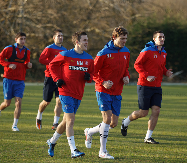 Matt McKay putting on a smile as he runs around with Nikica Jelavic