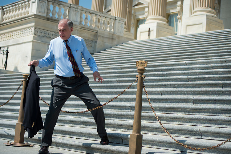 UNITED STATES – July 13: Rep. Pete Visclosky, D-Ind., steps over the chains on the House steps after casting his last vote before the weekend Friday July 13, 2018.  (Photo By Sarah Silbiger/CQ Roll Call)