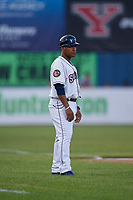 Mahoning Valley Scrappers coach Dennis Malave (28) during a NY-Penn League game against the Hudson Valley Renegades on July 15, 2019 at Eastwood Field in Niles, Ohio.  Mahoning Valley defeated Hudson Valley 6-5.  (Mike Janes/Four Seam Images)