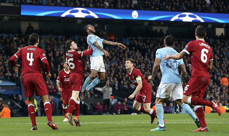 Manchester City's Raheem Sterling is pushed by Liverpool's Andrew Robertson but the challenge goes unpunished by Referee Antonio Miguel Mateu Lahoz<br /> <br /> Photographer Rich Linley/CameraSport<br /> <br /> UEFA Champions League Quarter-Final Second Leg - Manchester City v Liverpool - Tuesday 10th April 2018 - The Etihad - Manchester<br />  <br /> World Copyright &copy; 2017 CameraSport. All rights reserved. 43 Linden Ave. Countesthorpe. Leicester. England. LE8 5PG - Tel: +44 (0) 116 277 4147 - admin@camerasport.com - www.camerasport.com