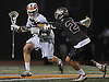 Steven Schneider #32 of Manhasset, left, gets pressured as he carries downfield during the 131st Woodstick Classic against Garden City at Manhasset High School on Saturday, April 29, 2017. Manhasset won by a score of 10-8.
