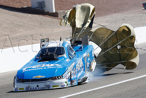 01.04.2016. Las Vegas, Nevada, USA. John Force (7 FC) JFR Chevrolet Camaro NHRA Funny Car deploys his parachutes after a qualifying run during the DENSO Spark Plugs NHRA Nationals at The Strip at Las Vegas Motor Speedway in Las Vegas, NV.