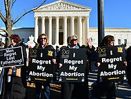 Washington, DC - January 19, 2018: Women hold signs in front of the U.S. Supreme Court as tens of thousands of people participate in the annual March for Life in Washington, D.C. January 19, 2018.  (Photo by Don Baxter/Media Images International)