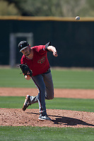Arizona Diamondbacks relief pitcher Lane Ratliff (18) follows through on his delivery during a Spring Training game against Meiji University at Salt River Fields at Talking Stick on March 12, 2018 in Scottsdale, Arizona. (Zachary Lucy/Four Seam Images)