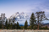 The Cathedral Group of peaks with a new frosting of autumn snow in Grand Teton National Park at sunrise.<br />