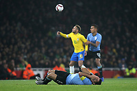 Luis Suarez of Uruguay lies on the ground in pain as play continues in the background during Brazil vs Uruguay, International Friendly Match Football at the Emirates Stadium on 16th November 2018