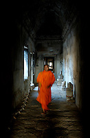 The movement of a Buddhist monk in the corridors of the famous Angkor Wat main temple, Siam Reap Cambodia
