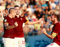 "Calcio, Serie A: Empoli vs Roma. Empoli, stadio ""Carlo Castellani"" 13 settembre 2014.<br /> Roma midfielder Radja Nainggolan, of Belgium, left, celebrates with teammates Miralem Pjanic, of Bosnia, center, and Daniele De Rossi, after Empoli goakeeper Luigi Sepe scored an own goal during the Italian Serie A football match between Empoli and AS Roma at Empoli's ""Carlo Castellani"" stadium, 13 September 2014.<br /> UPDATE IMAGES PRESS/Isabella Bonotto"