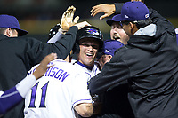 Alex Call (center) of the Winston-Salem Dash is surrounded by his teammates after executing a suicide squeeze bunt to walk-off the Salem Red Sox at BB&T Ballpark on April 21, 2018 in Winston-Salem, North Carolina.  The Dash walked-off the Red Sox 4-3.  (Brian Westerholt/Four Seam Images)