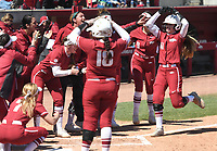 NWA Democrat-Gazette/J.T. WAMPLER The Arkansas squad celebrates as Danielle Gibson crosses home plate after hitting a solo home run against Kentucky Sunday March 31, 2019 at Bogel Park in Fayetteville. Arkansas won 3-2.