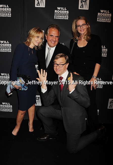 LAS VEGAS, NV - April 22: (L-R) 20th Century Fox Co-chairman Stacey Snider, Fox Filmed Entertainment Chairman and Chief Executive Officer Jim Gianopulos, President of Production, 20th Century Fox, Emma Watts and director Paul Feig (C) attend the Pioneer Dinner during 2015 CinemaCon at Caesars Palace on April 22, 2015 in Las Vegas, Nevada.