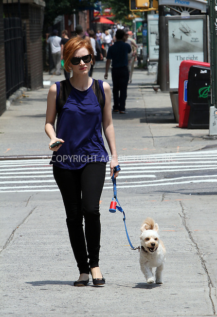 WWW.ACEPIXS.COM....July 23 2012, New York City....Jessica Chastain walks her dog Chaplain on the set of the new movie 'The Disappearance of Eleanor Rigby' film set on July 23, 2012 in New York City....By Line: Zelig Shaul/ACE Pictures......ACE Pictures, Inc...tel: 646 769 0430..Email: info@acepixs.com..www.acepixs.com