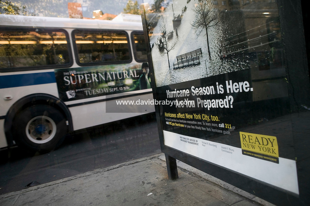 10 September 2005 - New York City, NY - A poster alerting New-Yorkers to hurricane preparedness stand in a bus shelter in the Lower East Side of Manhattan in New York, USA, 10 September 2005. The campaign, which was planned by the Office of Emergency Management long before Katrina hit southern states, went up across town during the first days of September. The zones at highest risk include lower Manhattan, Brooklyn's Coney Island, the Rockaways in Queens and the perimeter of Staten Island. Hurricane season in New York is from August to October, when waters along the East Coast are warmer. The city's worst hit, in 1938, caused more than 600 deaths. Photo Credit: David Brabyn.