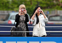 11.06.13 London, England. Fans taking photos during the The Aegon Championships from the The Queen's Club in West Kensington.