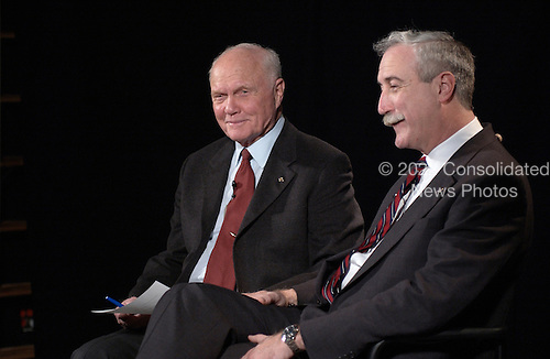 Former United States Senator John H. Glenn, Jr. (Democrat of Ohio), left, talks by satellite to the crew on board the International Space Station February 20, 2002 at NASA headquarters in Washington, DC. Glenn stopped by NASA to commemorate the 40th anniversary of his historic Project Mercury orbital flight. On February 20, 1962, Glenn became the first American to orbit the Earth, hurtling around the globe three times in a flight that lasted nearly five hours. At right is NASA Administrator Sean O'Keefe..Mandatory Credit: Bill Ingalls / NASA via CNP