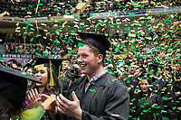 Michael J. Pearce, B.S. Health Sciences, applauds during UAA's Fall 2018 Commencement Ceremony at the Alaska Airlines Center.