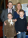 Tiarnan Rowley who received his first holy communion in St Mary's church pictured with parents Cormac and Brenda and brother Odhran. Photo:Colin Bell/pressphotos.ie