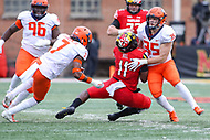 College Park, MD - October 27, 2018: Illinois Fighting Illini linebacker Jake Hansen (35) tackles Maryland Terrapins quarterback Kasim Hill (11) during the game between Illinois and Maryland at  Capital One Field at Maryland Stadium in College Park, MD.  (Photo by Elliott Brown/Media Images International)