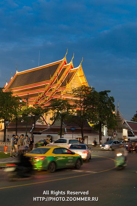 Illuminated buddist pagoda in Phra Buddhasaiyas temple, Bangkok, Thailand