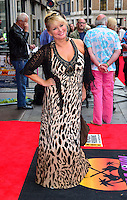 Cheryl Baker<br /> The &quot;Bula Quo!&quot; UK film premiere, Odeon West End cinema, Leicester Square, London, England.<br /> July 1st, 2013<br /> full length black crochet cardigan brown leopard print dress hand on hip<br /> CAP/BF<br /> &copy;Bob Fidgeon/Capital Pictures