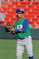 Third baseman Mauricio Ramos (3) of the Lexington Legends warms up before a game against the Greenville Drive on Wednesday, June 4, 2014, at Fluor Field at the West End in Greenville, South Carolina. Lexington won, 9-3. (Tom Priddy/Four Seam Images)