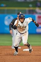 David Fletcher (15) of the Salt Lake Bees hustles towards third base against the Albuquerque Isotopes at Smith's Ballpark on April 5, 2018 in Salt Lake City, Utah. Salt Lake defeated Albuquerque 9-3. (Stephen Smith/Four Seam Images)