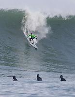 Grant Washburn surfs down a face at the 2008 Mavericks Surf Contest in Half Moon Bay, Calif., Saturday, January 12, 2008.