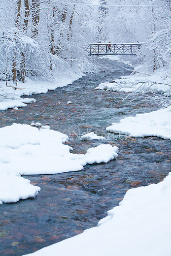 The footbridge across Rattlesnake Creek in Greenough Park on a snowy day in Missoula, Montana