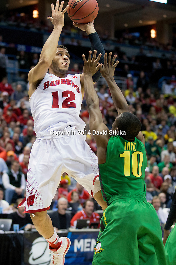 Wisconsin Badgers guard Traevon Jackson (12) during the third-round game in the NCAA college basketball tournament against the Oregon Ducks Saturday, April 22, 2014 in Milwaukee. The Badgers won 85-77. (Photo by David Stluka)